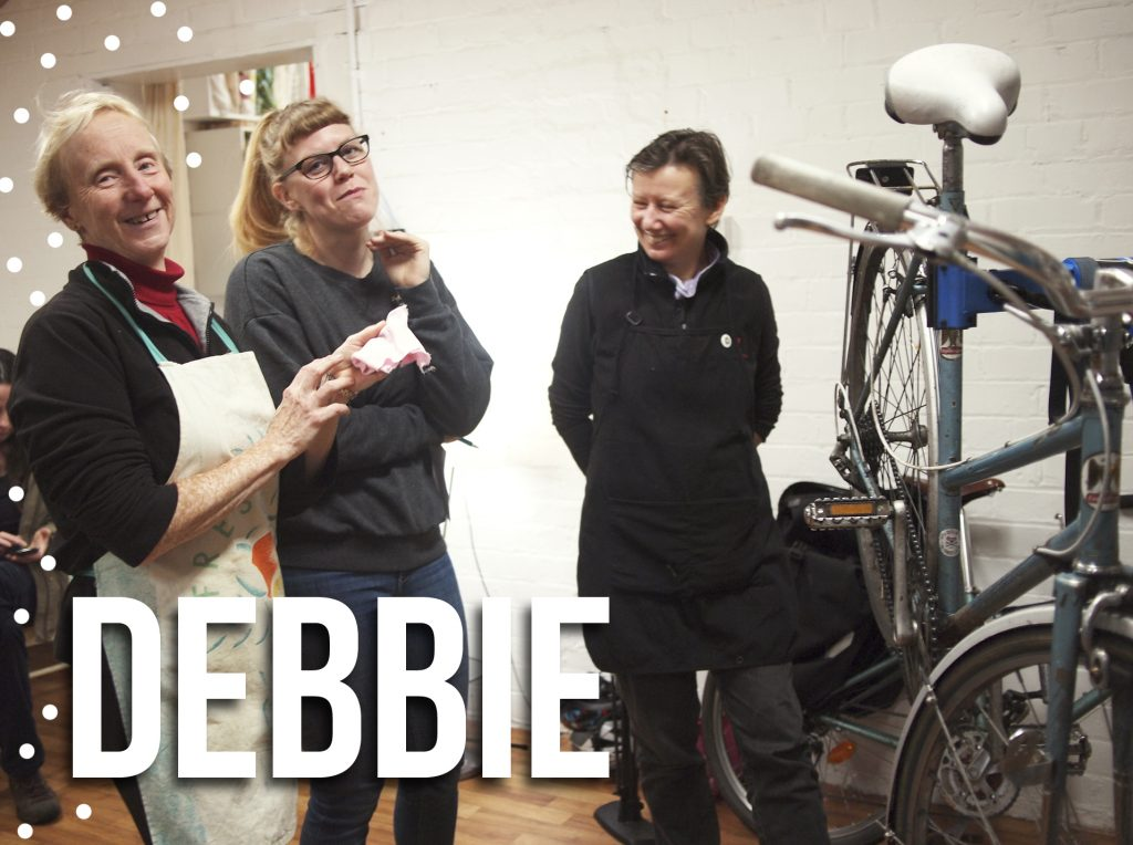 Debbie teaching bike fixing at Manchester Repair Cafe